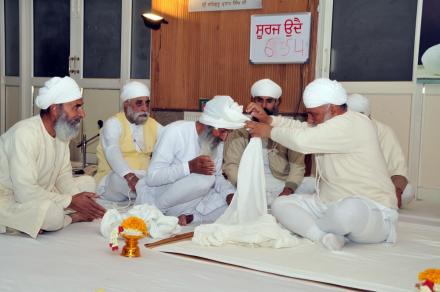 Sri Satguru Ji tying turban during bhog ceremony of Sant Pyara Singh Ji