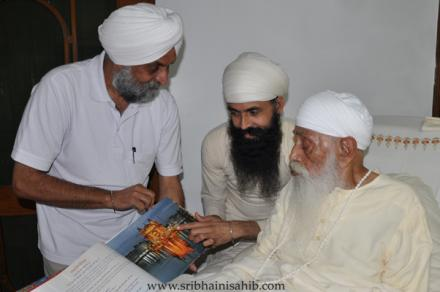 "Visual Artist TPS Sandhu presents his book ''RAAG RATTAN"" to His Holiness"