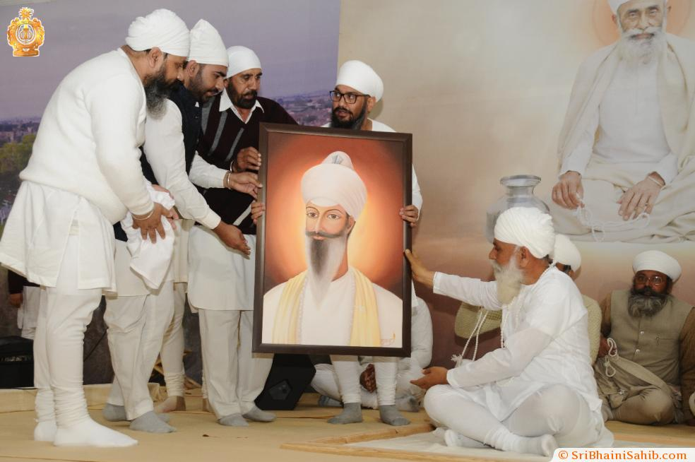 Artist Arshdeep Singh with his painting of Sri Satguru Ram Singh Ji on 25-Dec-2016