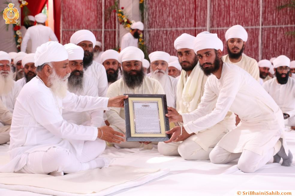 "Sri Satguru Ji honoring the family of (Late) Sant Balkaar Singh Ji with ""Nishkam Sewak puraskar"" for his selfless devotion toward Namdhari Panth. (26 March 2016)"